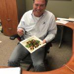 Principal Bob O Connor eats salad