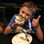 boy eating thai turkey tacos