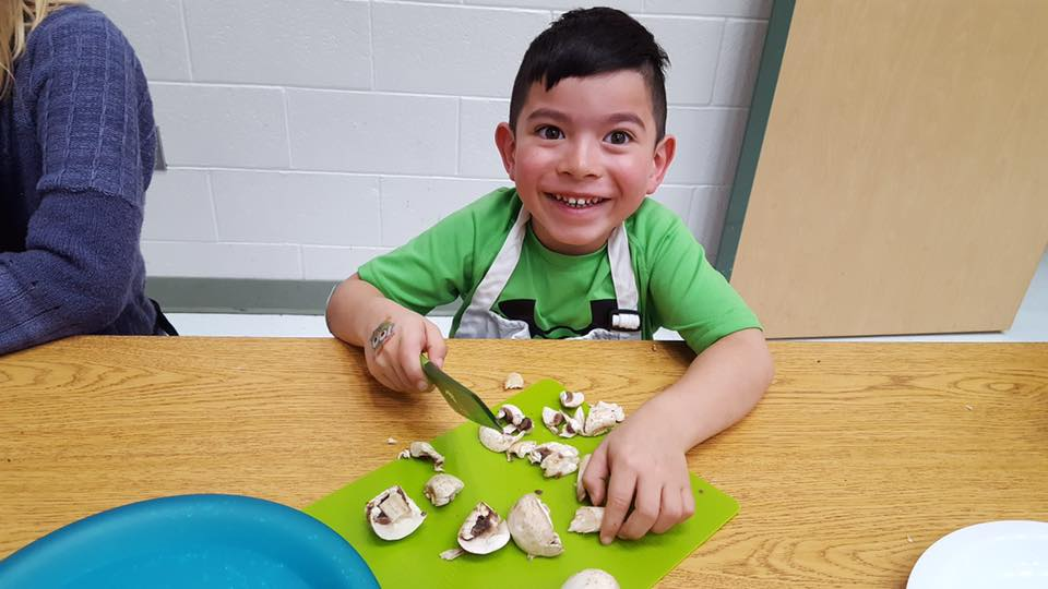 boy cutting mushrooms