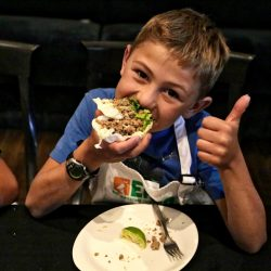 boy eating thai turkey tacos
