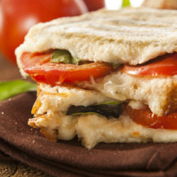 Tomato and Mozzarella Panini with Arugula and Pesto